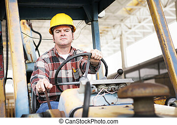 Heavy Equipment Driver - Worker driving heavy construction...