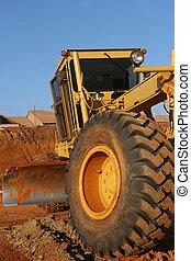 Heavy equipment : Grader - Heavy earth moving equipment busy...