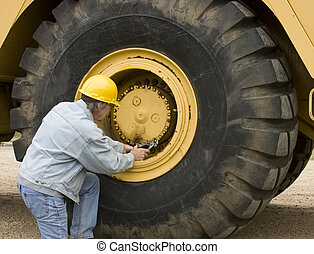 Heavy equipment mechanic - Mechanic working on a huge tire ...