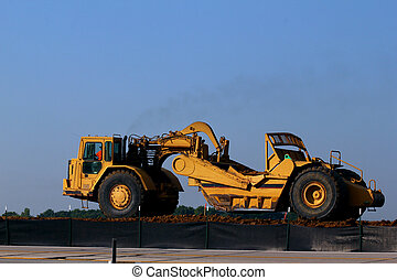 Heavy Equipment Roads - Heavy equipment moving dirt on road ...