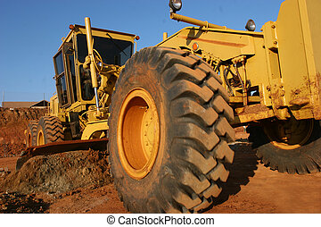 Heavy equipment scraping a road - Heavy earth moving ...