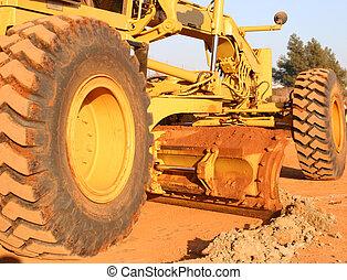 Heavy equipment scraping road top