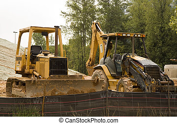 Heavy Equipment - Two pieces of heavy construction equipment...