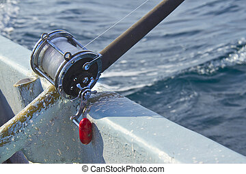heavy fishing reel on the shipboard
