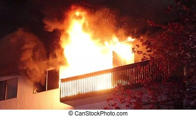 Residential building's balcony fully involved in heavy flames and smoke