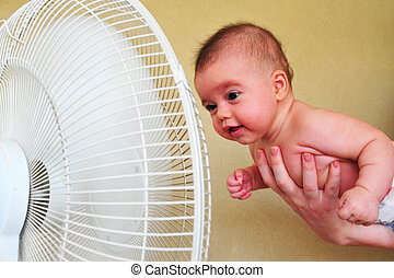 Heavy Heat Wave - TEL AVIV - AUG 19: Baby cools down with a...