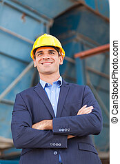 heavy industry businessman with arms folded