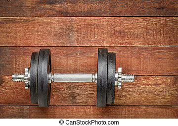heavy iron dumbbell - fitness concept
