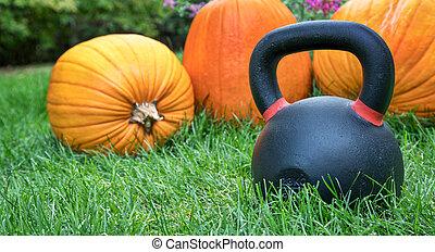 heavy kettlebell and pumpkins - heavy iron kettlebell and...