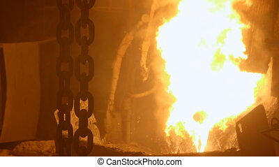Heavy lifting chains by the blast furnance at a...