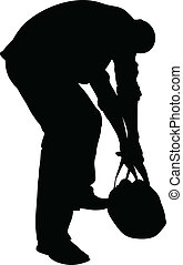 Heavy Lifting - A silhouette of a man trying to lift a heavy...