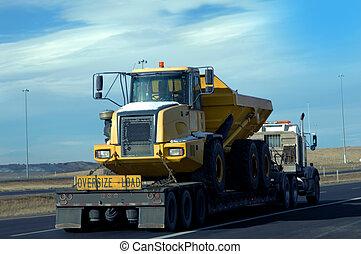 Heavy Load - Eighteen wheeler hauls a heavy, oversized dump...