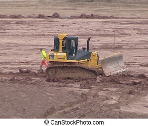 Heavy machinery dig ground. Site preparation for...