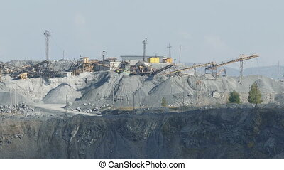 Heavy machinery of gravel production in quarry