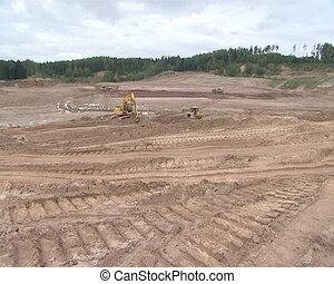 Heavy machinery preparing construct - Heavy machinery is...