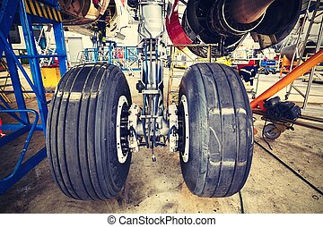 Heavy maintenance - Chassis of the airplane under heavy...