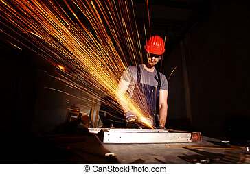 manual worker cut metal with electric grinder