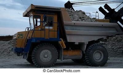Heavy mining dump truck being loade