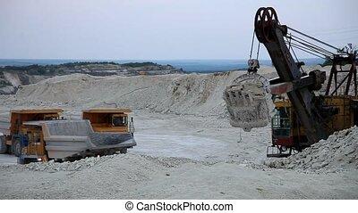 Heavy mining dump trucks driving