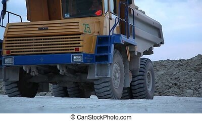 Heavy mining dump trucks driving
