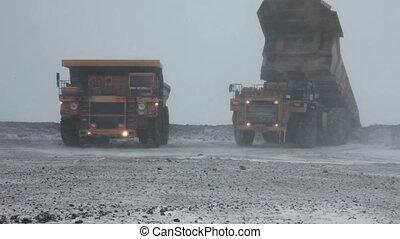 Heavy mining dump trucks