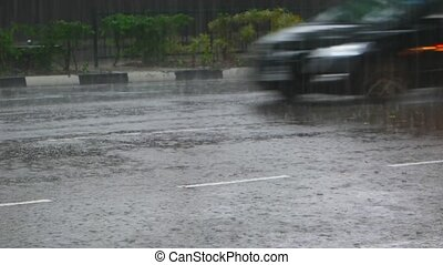 Heavy Monsoon Rains on a Busy Section of Highway in Southeast Asia