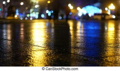 Heavy Rain, Busy Street. Car and Traffic Lights Reflect on a Rainy Road at Night.