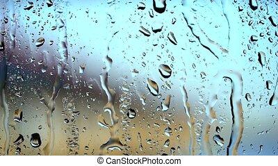 Heavy rain drop on window . Blurry background - Heavy rain...