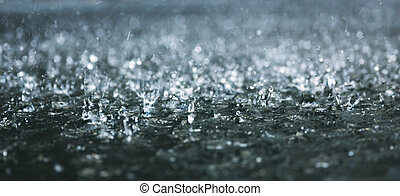 Heavy rain - Drops of heavy rain on water