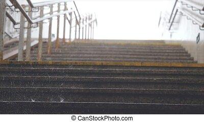 Heavy rain falling on marble steps in slow motion. - Heavy...