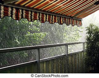 Heavy Rain - Heavy rain in the summer time under an awning
