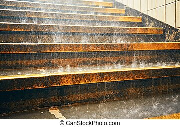 Heavy rain in the city. Rain droplets on the staircase...