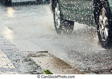 Heavy rain in the city - Traffic in rainy day in the city. ...