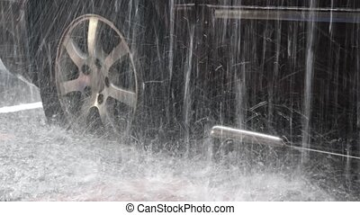 Heavy Rain on a Parked Car with High Water