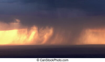 Heavy rain on the horizon - Powerful rainstorm at sunset...