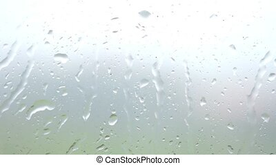Heavy rain on window glass background. slow motion....