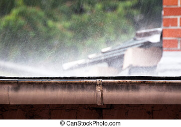 Heavy rain - rain falling heavily on roof in summer