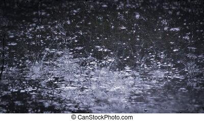 Heavy rain shower downpour cloudburst rainfall behind the ...