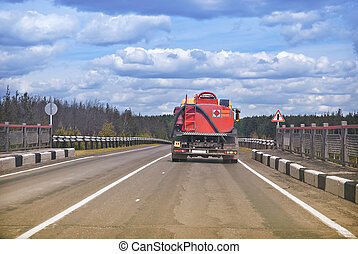 Heavy refueller truck - Lonely automobile track on the road....