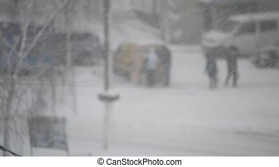 Heavy snow falling in a city - Heavy slanting snow falling...
