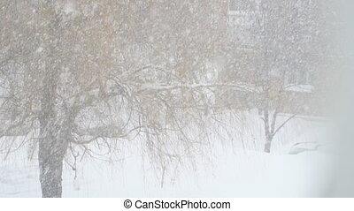 Heavy snow falls, snowstorm on the background of house