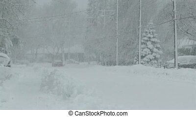 Winter season: reduced visibility and intense snowfall over residential area.