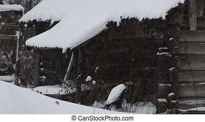 Heavy snowfall, an abandoned house