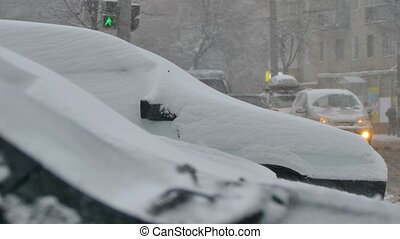 Heavy snowfall in the city. Snowstorm snapped cars and...