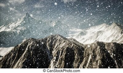Heavy snowing, focused on the snowflakes, mountains in the background