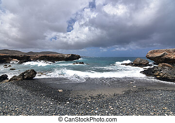 Heavy Thick Gray Clouds Above the Black Sand Beach