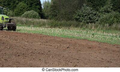 heavy tractor plow field