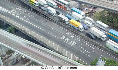 heavy traffic jam time-lapse Hong Kong. pan up