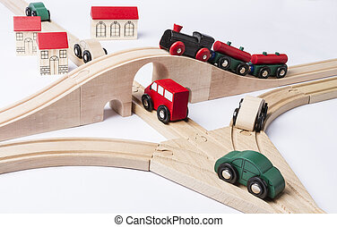 heavy traffic near small toy town. train on bridge and some...