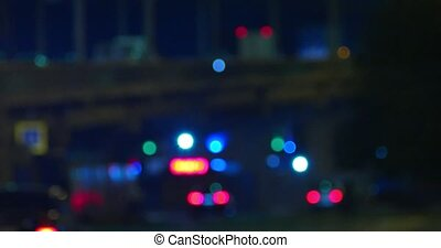 Heavy traffic on overpass in the night defocused shoot